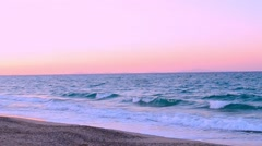Pink sunset by the sea Stock Footage