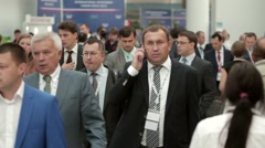 Walking busy businessman Crowd congress hall on International Investment Forum - stock footage