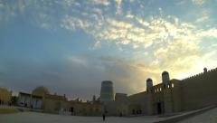 KHIVA, UZBEKISTAN -  Kuhna Ark citadel and Kalta Minor Minaret at sunset Stock Footage