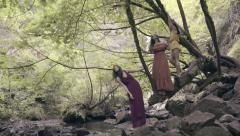 3 Enchanting Models Pose In A Magical Woodland Setting, Waterfall In Background Stock Footage