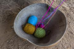 Rolls of colored thread in a calabash shell - stock photo