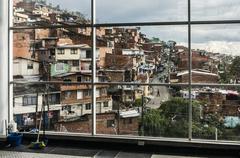 Medellin suburbs through a window. - stock photo