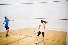 Stock Photo of Competitive couple playing squash together