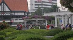 People sitting on Merdeka square,Kuala Lumpur,Malaysia Stock Footage