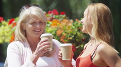 4K Portrait of beautiful mother and daughter laughing together outdoors - stock footage