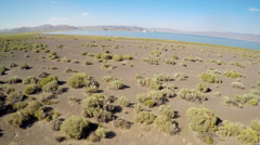 An aerial view over the Nevada desert with Pyramid lake background. Stock Footage