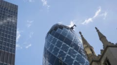 Time lapse video of  window cleaners working on the  Swiss Re building common - stock footage