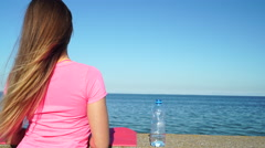 Stock Video Footage of Woman resting after doing sports outdoors drinking water 4K