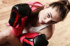 Fit sporty woman boxing Stock Photos