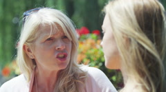 4K Close-up portrait of young woman getting a serious talking to by mother Stock Footage