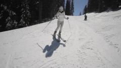 Woman skier go down on ski route - stock footage