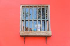 Window with an old weight scale Stock Photos