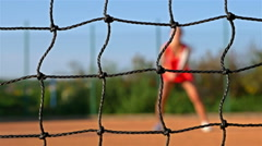 Girl Tennis Player expecting the Tennis Ball On Clay Court, net in front, dolly Stock Footage