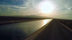 An aerial view over the Los Angeles aqueduct at sunset. Arkistovideo