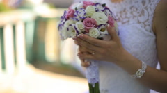 the bride holding a bouquet - stock footage