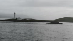 Passing Eilean Musdile lighthouse off coast of Lismore Scotland Stock Footage