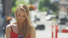 4K Portrait of beautiful young woman with mobile phone outdoors in the city Stock Footage
