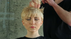 Closeup on young woman getting new hairdress by hairdresser - stock footage