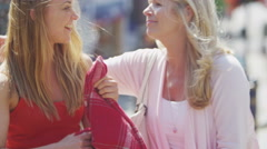 4K Portrait of beautiful mother & daughter laughing together outdoors in city - stock footage