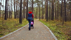 Walk with the child in autumn Stock Footage