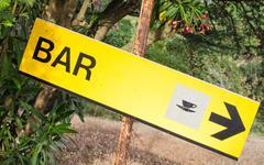 Yellow signboard bar Stock Photos