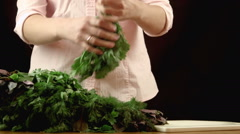The girl sorts herbs Stock Footage