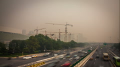 China's capital city of Beijing street traffic of automobiles. Foggy day, smog,  - stock footage