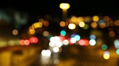 Defocused traffic with sound at night - stock footage