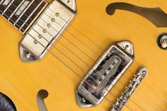 Top view of yellow electric guitar - stock photo