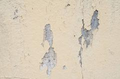 Old wall texture with peeling paint - stock photo