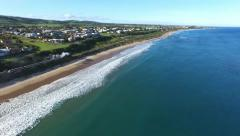 Historical railway vintage steam train aerial along coast Stock Footage