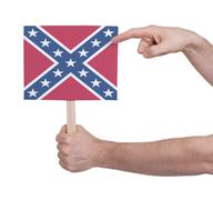 Hand holding small card - Flag of the Confederacy - stock photo