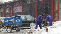 Chinese men shoveling snow, Beijing China Stock Footage