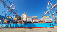 Port dock with Mega container ship - stock footage