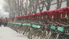Pedicab rickshaws in snow, Beijing China Stock Footage