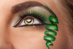 Fashion on stage make up with whirl at the eye - stock photo