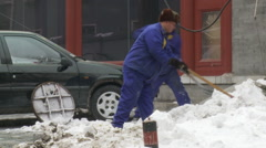 Chinese workers shovel snow, Beijing, China Stock Footage