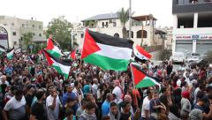 Arab Israeli Muslim activists march with PLO flags in anti Israel protest - stock footage
