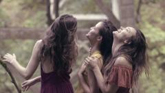 3 Young Women Enjoy Nature, Look Up Into The Forest (4K) Stock Footage