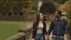 In Love Interracial couple walking in a park - stock photo