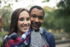 In Love Interracial couple hugging - stock photo