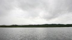 Boat moving in the lake at Kanjanaburi province, Thailand. It's rainy season. Stock Footage