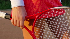 Close up of tennis player legs and hands with tennis racket Stock Footage