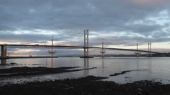 Timelapse of Forth Road Bridge at dawn Scotland Stock Footage
