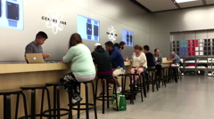 People buying new iphone inside Apple store - stock footage