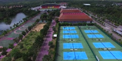 aerial flight over tennis courts - stock footage
