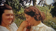 1956: Bride helping maid pin corsage on wedding dress. - stock footage