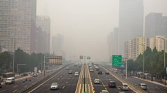 China's capital city of Beijing street traffic of automobiles. Foggy day, smog,  Stock Footage