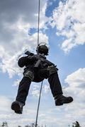 rappeling assault - stock photo