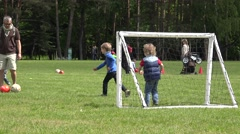 Father with child play football in green park. 4K Stock Footage